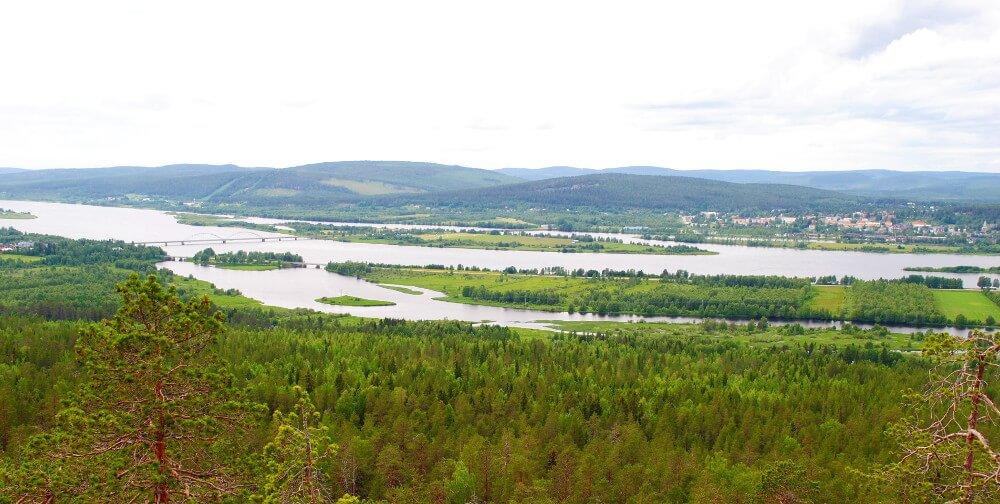 big natural river in lush plain